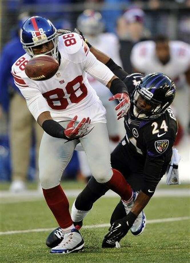 Baltimore Ravens cornerback Corey Graham, back, breaks up a pass-attempt to New York Giants wide receiver Hakeem Nicks in the first half of an NFL football game in Baltimore, Sunday, Dec. 23, 2012. (AP Photo/Nick Wass) Photo: ASSOCIATED PRESS / AP2012