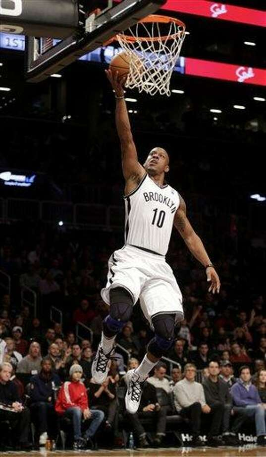 Brooklyn Nets' Keith Bogans makes a basket on a breakaway during the first half of an  NBA basketball game against the Philadelphia 76ers at the Barclays Center Sunday, Dec. 23, 2012 in New York.  (AP Photo/Seth Wenig) Photo: ASSOCIATED PRESS / AP2012