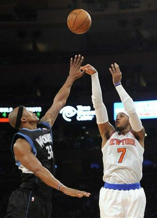New York Knicks' Carmelo Anthony (7) shoots over Minnesota Timberwolves' Dante Cunningham (33) in the first half of an NBA basketball game on Sunday, Dec., 23, 2012, at Madison Square Garden in New York. The Knicks won 94-91. (AP Photo/Kathy Kmonicek) Photo: ASSOCIATED PRESS / AP2012