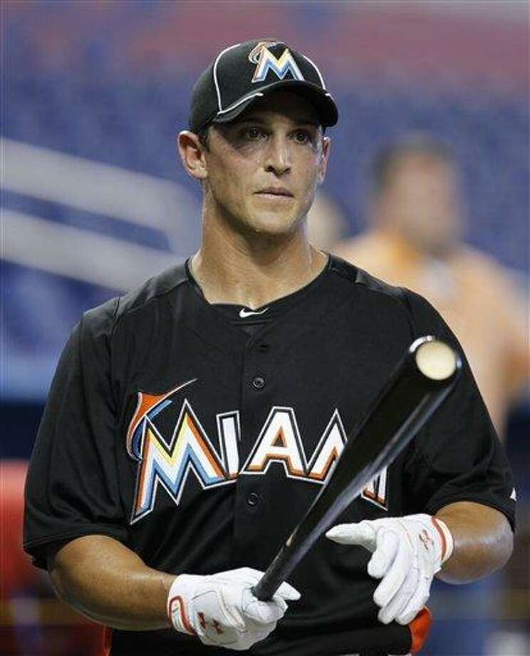 Adam Greenberg prepares for batting practice before a baseball game against the New York Mets in Miami, Tuesday, Oct. 2, 2012. The Miami Marlins signed the former Chicago Cubs prospect to a one-day contract effective Oct. 2, and play him that day against the New York Mets. (AP Photo/Alan Diaz) Photo: ASSOCIATED PRESS / AP2012
