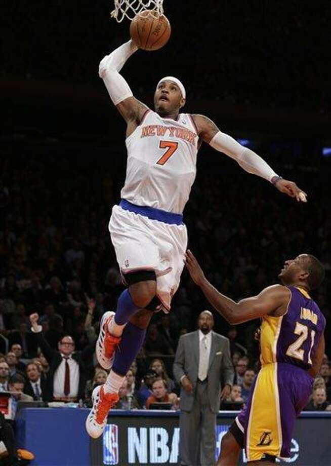 New York Knicks forward Carmelo Anthony (7) goes up for a layup over Los Angeles Lakers guard Chris Duhon (21) in the first half of their NBA basketball game at Madison Square Garden in New York, Thursday, Dec. 13, 2012.  The Knicks defeated the Lakers 116-107. (AP Photo/Kathy Willens) Photo: ASSOCIATED PRESS / AP2012