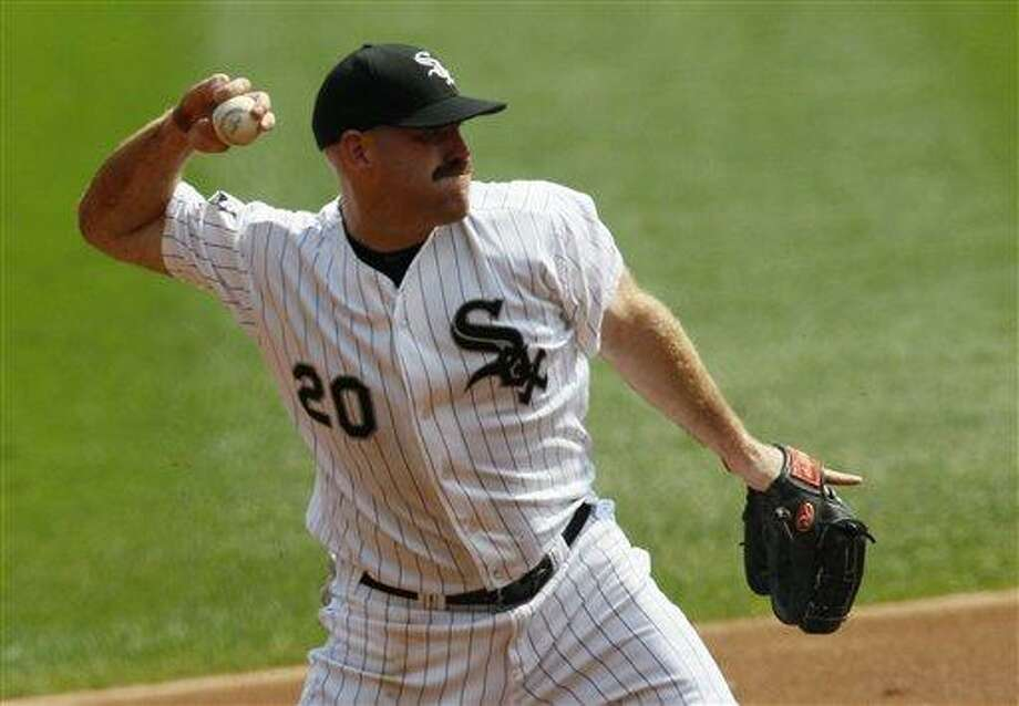 Chicago White Sox third baseman Kevin Youkilis fields his position during a baseball game against the Detroit Tigers Monday, Sept. 17, 2012, in Chicago. The White Sox won 5-4. (AP Photo/Charles Rex Arbogast) Photo: ASSOCIATED PRESS / AP2012