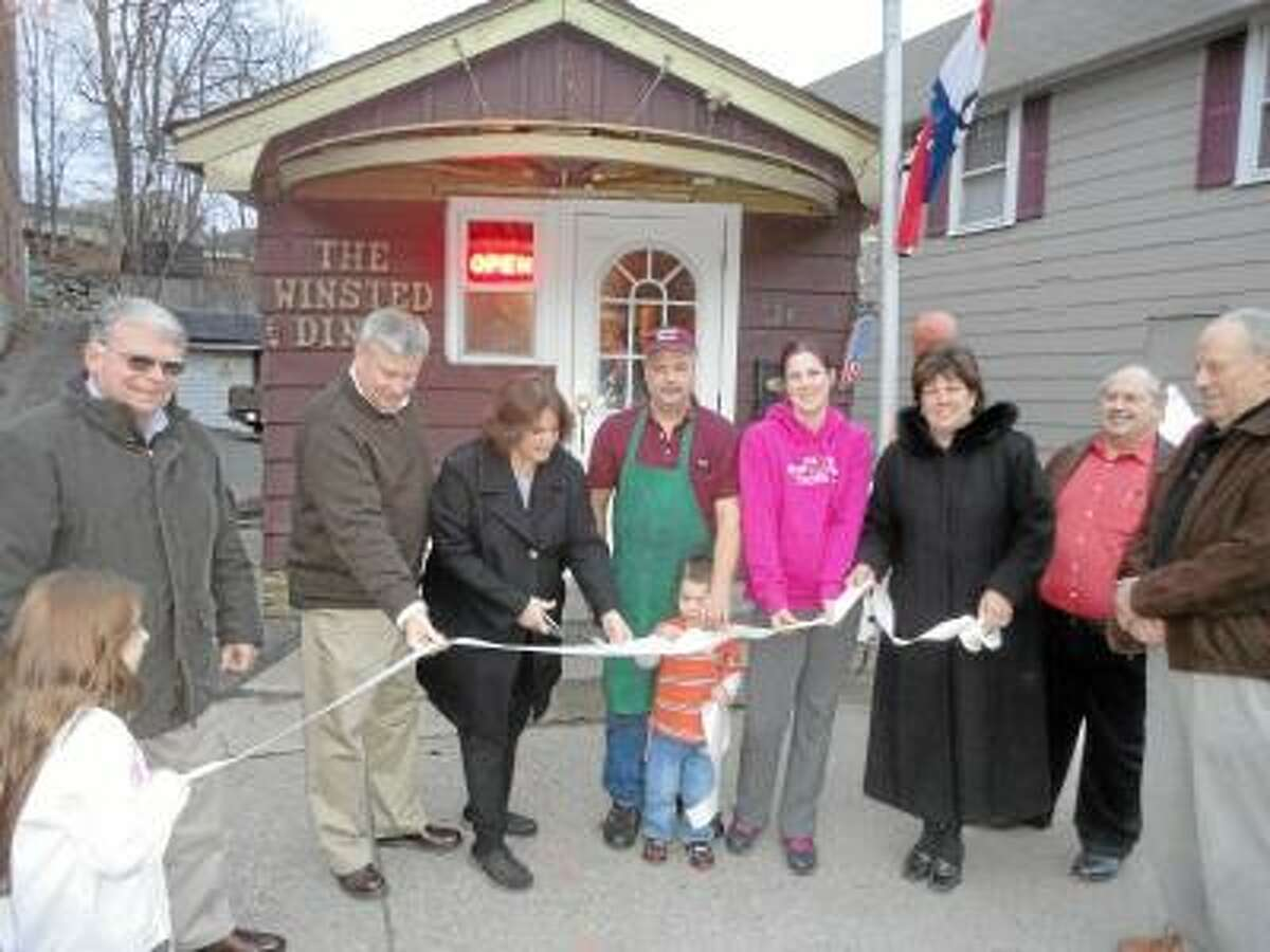 JASON SIEDZIK/ Register Citizen Winchester Mayor Maryann Welcome, third from left, prepares to cut the ribbon at the Winsted Diner's reopening.