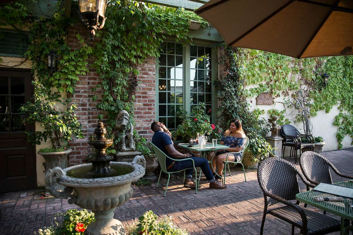 Visitors to the Dancing Fox Winery & Brewery enjoy the outdoor patio seating at the restaurant and bar in Lodi, Calif., on Saturday, August 19, 2017. Located in the heart of downtown Lodi, Dancing Fox has one of the best beer selections in town with fifteen taps pouring their own brews as well as other craft beers.