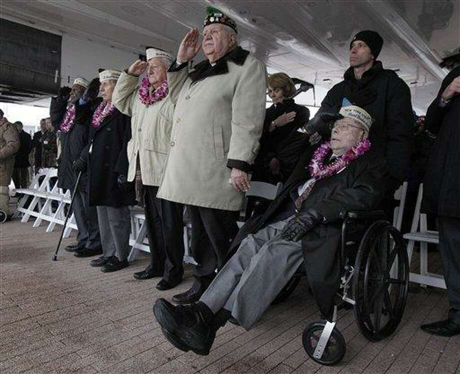 Pearl Harbor survivors, from left, Clark Simmons, of Brooklyn, N.Y.; Aaron Cahbin, of Bayside, N.Y.; Armando Chick Galella, of Sleepy Hollow, N.Y.; Chaplin William Kalaidjain, and Daniel Fruchter, of Eastchester, N.Y., salute during ceremonies at the Intrepid Sea, Air and Space Museum. in New York, commemorating the 71st anniversary of the attack at Pearl Harbor, Friday, Dec. 7, 2012. President Barack Obama marked the day on Thursday by issuing a presidential proclamation, calling for flags to fly at half-staff on Friday and asking all Americans to observe the day of remembrance and honor military service members and veterans. (AP Photo/Richard Drew) Photo: ASSOCIATED PRESS / AP2012