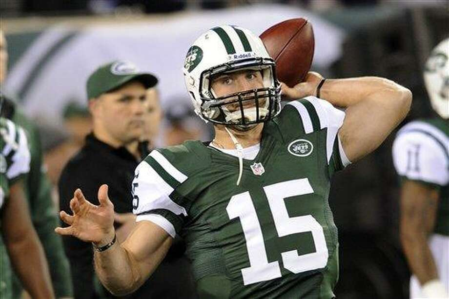 FILE - This Nov. 22, 2012 file photo shows New York Jets quarterback Tim Tebow (15) warming up before an NFL football game in East Rutherford, N.J. The New York Jets and their quarterback controversy have turned into Washington's political football. In remarks on the Senate floor Friday, Senate Majority Leader Harry Reid of Nev. said the Jets have three quarterbacks _ Sanchez, Tebow and Greg McElroy, who replaced Sanchez last Sunday and led the team to its only touchdown in a 7-6 win over the Arizona Cardinals. Reid said Republicans can't decide on their leader either. (AP Photo/Bill Kostroun, File) Photo: ASSOCIATED PRESS / AP2012