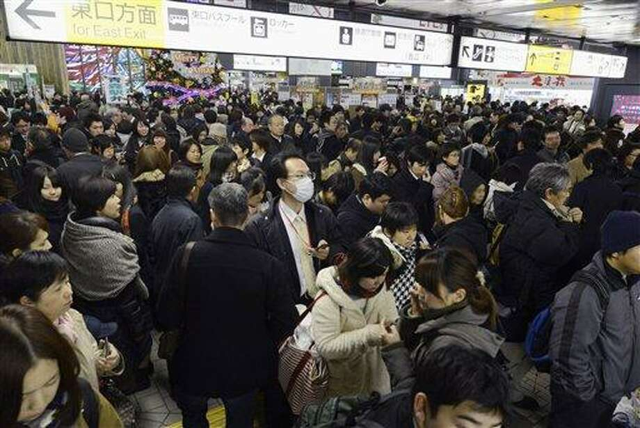People crowd at Sendai railway station in Sendai, Miyagi Prefecture, Friday, Dec. 7, 2012 after trains were halted following a strong earthquake struck off the coast of northeastern Japan. It is the same region that was hit by a massive earthquake and tsunami last year. (AP Photo/Kyodo News) JAPAN OUT, MANDATORY CREDIT, NO LICENSING IN CHINA, FRANCE, HONG KONG, JAPAN AND SOUTH KOREA Photo: AP / Kyodo News