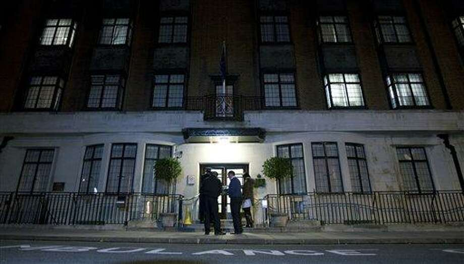 In this Dec. 3 file photo, policeman stand guard outside the King Edward VII hospital in London where the Duchess of Cambridge had been admitted with a severe form of morning sickness. King Edward VII hospital says the nurse involved in Kate hoax call has died Friday. (AP Photo/Alastair Grant, File) Photo: AP / AP