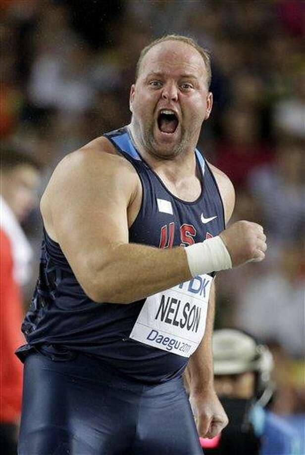 USA's Adam Nelson competes in the Men's Shot Put final at the World Athletics Championships in Daegu, South Korea, Friday, Sept. 2, 2011. (AP Photo/David J. Phillip) Photo: ASSOCIATED PRESS / AP2011