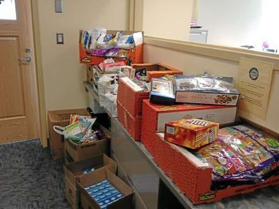 RICKY CAMPBELL/ Register Citizen The Mayor's Office in City Hall was stacked with goodies for a Christmas care package, which will be shipped out Monday. The goods are going to four soldiers serving in Afghanistan, all from Torrington.