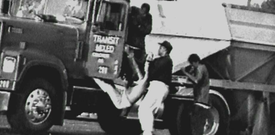 """Footage from the documentary """"Let It Fall: Los Angeles 1982-1992"""" shows people dragging a man from his truck before he was beaten during the riots. Photo: Lincoln Square Productions"""