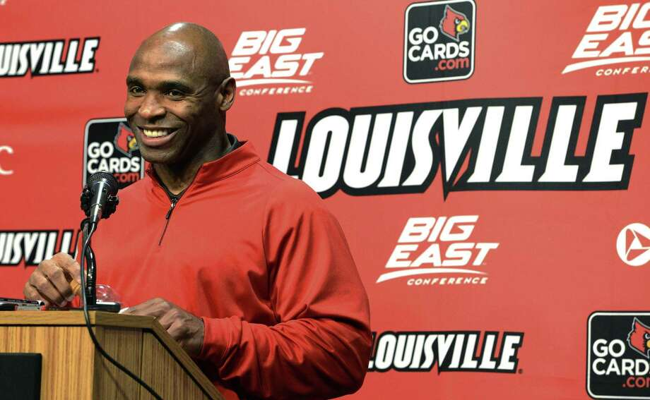 Louisville head football coach Charlie Strong smiles at a reporters question during a news conference Thursday, Dec. 6, 2012, in Louisville, Ky. Strong announced this morning that he has turned down the head coaching job offer from the University of Tennessee and will stay at Louisville. (AP Photo/Timothy D. Easley) Photo: ASSOCIATED PRESS / Timothy D. Easley2012
