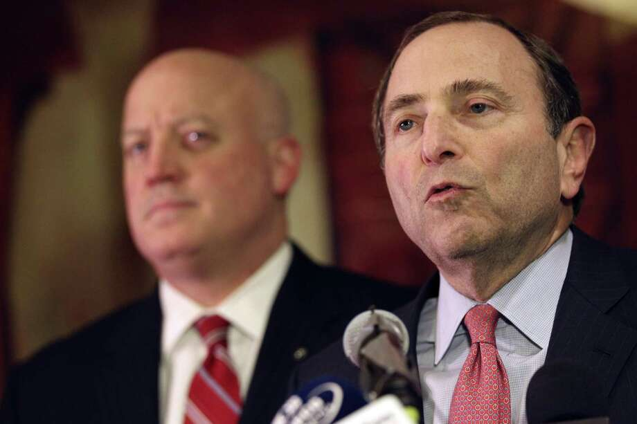 NHL commissioner Gary Bettman, right, and deputy commissioner Bill Daly and speak to reporters on Thursday, Dec. 6, 2012, in New York. The NHL has rejected the players' latest offer for a labor deal and negotiations have broken off at least until the weekend. (AP Photo/Mary Altaffer) Photo: ASSOCIATED PRESS / AP2012