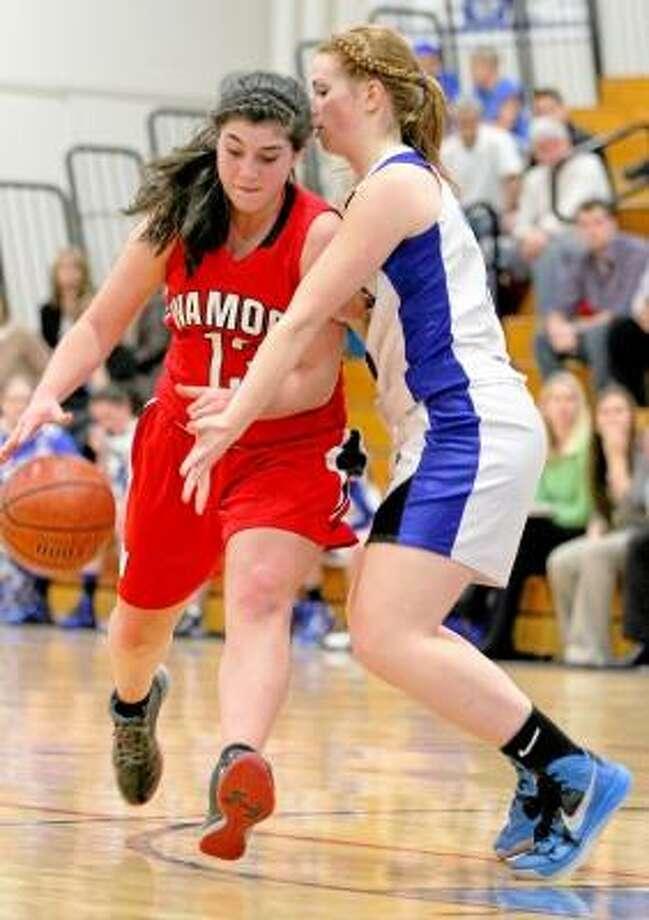 Wamogo's Jenna Lopardo controls the ball as Spartan Teagan Dunn defends. Photo by Marianne Killackey/Special to Register Citizen / 2012