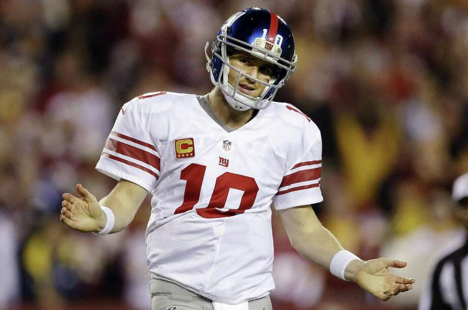 New York Giants quarterback Eli Manning reacts to a play during the second half of an NFL football game against the Washington Redskins in Landover, Md., Monday, Dec. 3, 2012. (AP Photo/Patrick Semansky) Photo: ASSOCIATED PRESS / AP2012