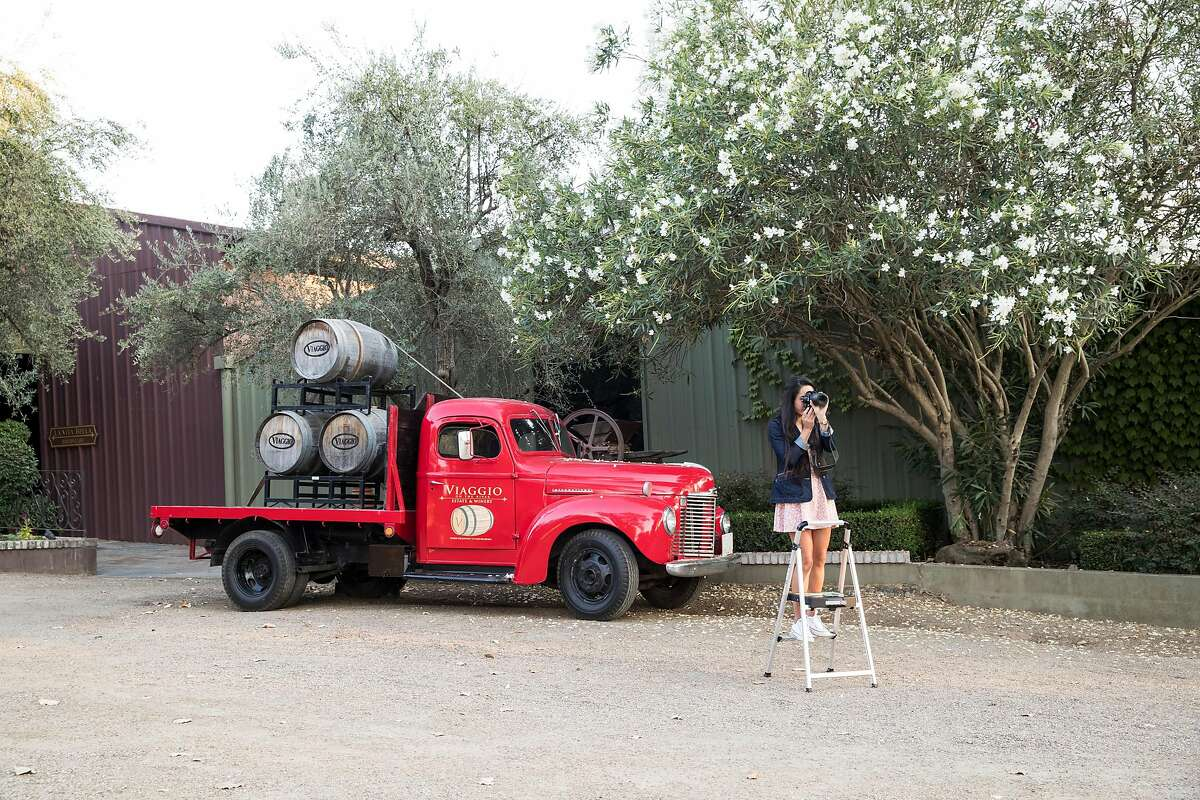 Priscilla Zaragoza works on taking graduation portraits at Viaggio Estate & Winery in Acampo, Calif., on Friday, August 18, 2017. The winery is available as a wedding venue and offers all inclusive wedding packages.