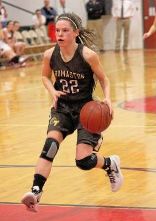 Thomaston guard Maggie Eberhardt dribbles up the court during the Golden Bears game against Wamogo on February 1st 2012. The Golden Bears won the 2011-2012 Berkshire League title. Photo by Marianne Killackey/Special to Register Citizen