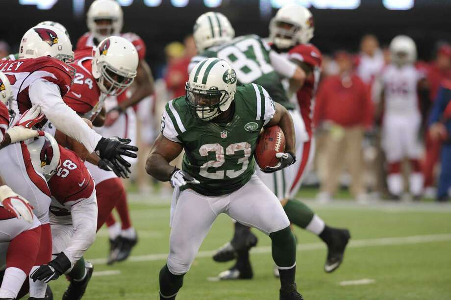 New York Jets running back Shonn Greene (23) carries the ball during the second half of an NFL football game against the Arizona Cardinals, Sunday, Dec. 2, 2012, in East Rutherford, N.J. The Jets won 7-6. (AP Photo/Bill Kostroun) Photo: ASSOCIATED PRESS / AP2012