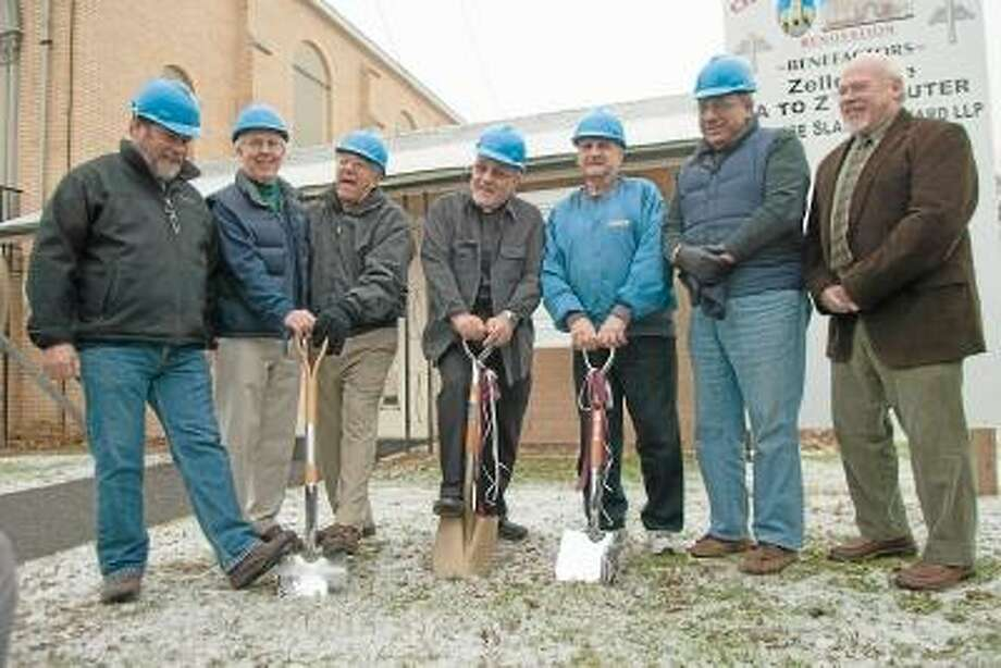 Max Lauf/Register Citizen Participating in the groundbreaking at St. Maron's Church in Torrington are, left to right, Jack Baer, David Leard, Michael Nejaime, Father Larry Michael, Joe Savopolis, Sam Slaiby, and Mike Boe. / Max WIlliam Lauf