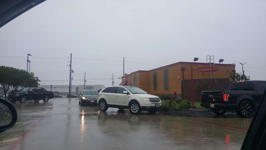 A line of cars wraps around Popeye's on FM 1960 in Humble. Photo: Melanie Feuk