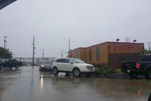 A line of cars wraps around Popeye's on FM 1960 in Humble.