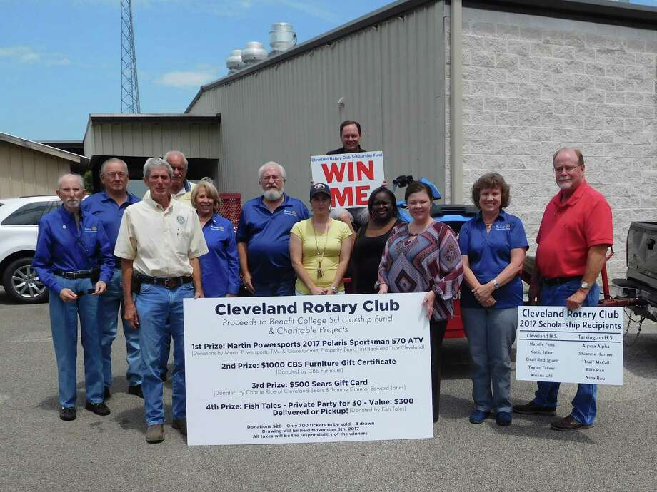 Pictured at the kickoff (top with Win Me sign) Rotary President Scott Lambert; (left to right) Rotarians Tommie Daniel, Kenneth Riggs, James Leach, Bob Coleman, Ernestine Belt, Larry Middleton, Amanda Brooks, Eisha Jones, Tasha Childress, Claire Garrett, and Charlie Rice. Photo: Submitted