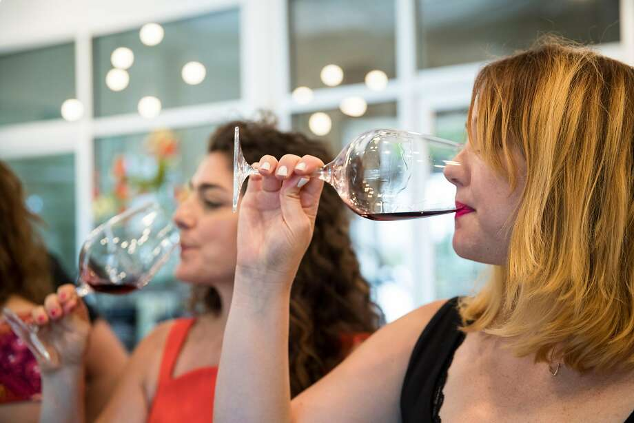 Shana Robinson, left, and Andrea Heap participate in a tasting at Bokisch Vineyards in Lodi. Photo: Laura Morton, Special To The Chronicle