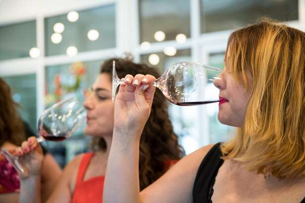 Shana Robinson (left) and Andrea Heap participate in a tasting in the tasting room of Bokisch Vineyards in Lodi, Calif., on Saturday, August 19, 2017. The winery specializes in Spanish varietals and Tizona wines.