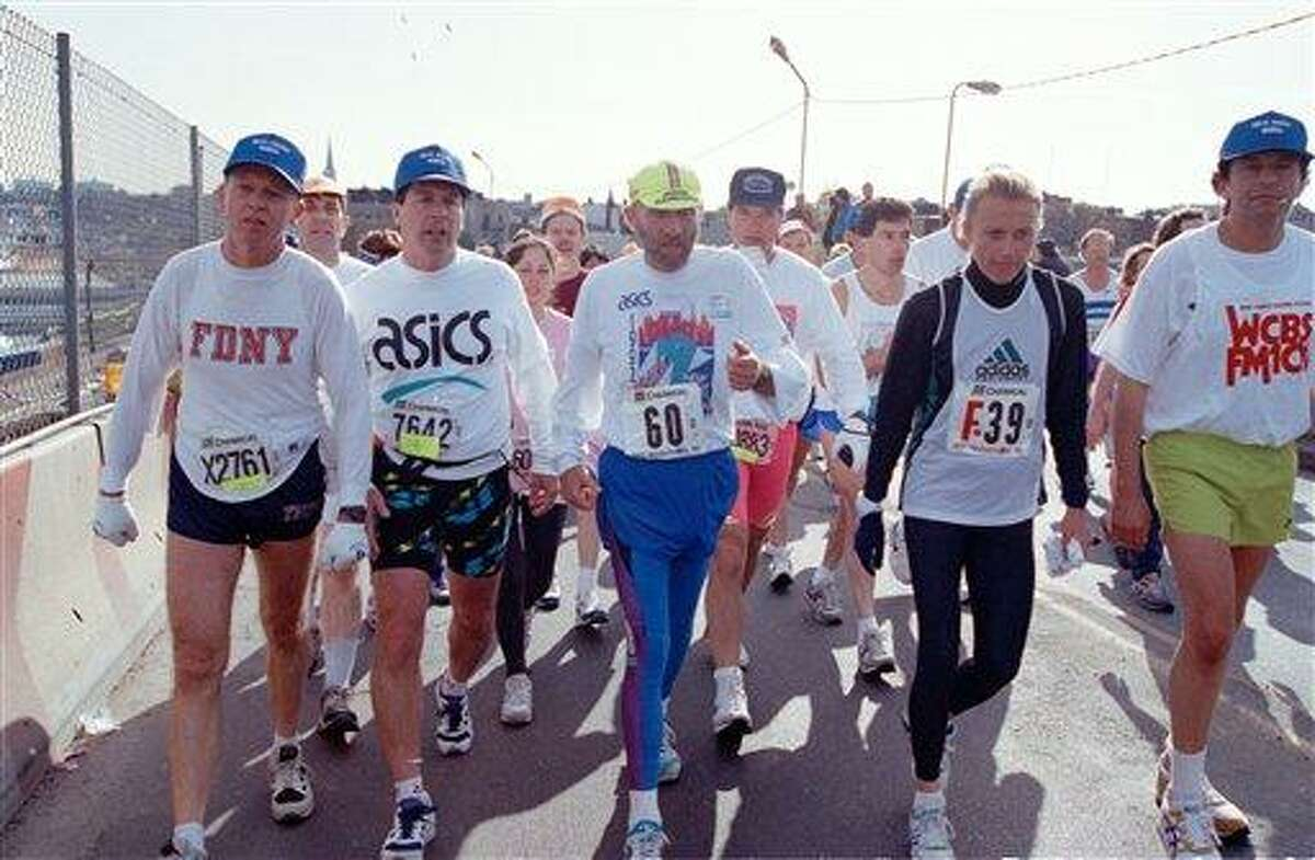 FILE -- In a Nov. 1, 1992, file photo Fred Lebow (60) and Grete Waitz (F39) cross the Pulaski Bridge on the border of the Brooklyn and Queens boroughs of New York during the New York City Marathon. Lebow, the creator and impressario of the Marathon has not run in the race for more than 20 years, while Waitz has won the marathon a record nine times. Waitz died Tuesday April 19, 2011 after a six-year battle with cancer, Norway's athletics federation said. She was 57. (AP Photo/Alex Brandon/file)