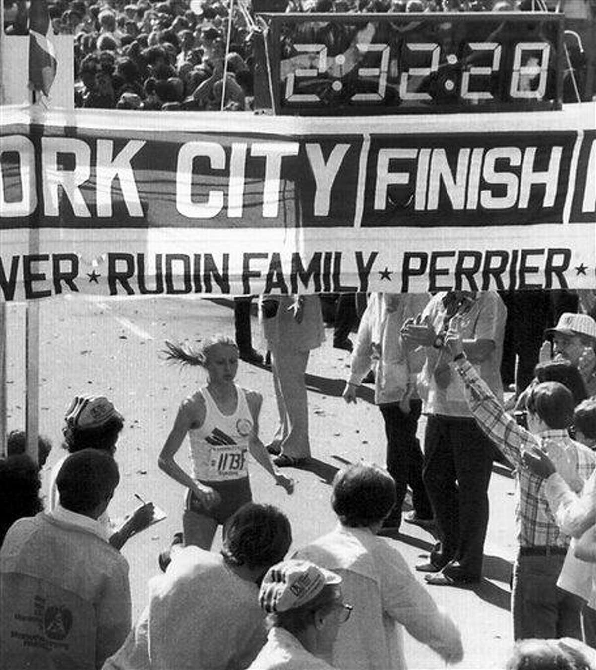 FILE - This Oct. 22, 1978, file photo shows Grete Waitz crossing the finish line to win her first New York City Marathon, in New York. Waitz, the Norwegian runner who won nine New York City Marathons and the silver medal at the 1984 Los Angeles Olympics, died in Oslo, Norway Tuesday, April 19, 2011 after a six-year battle with cancer. She was 57. (AP Photo/File)