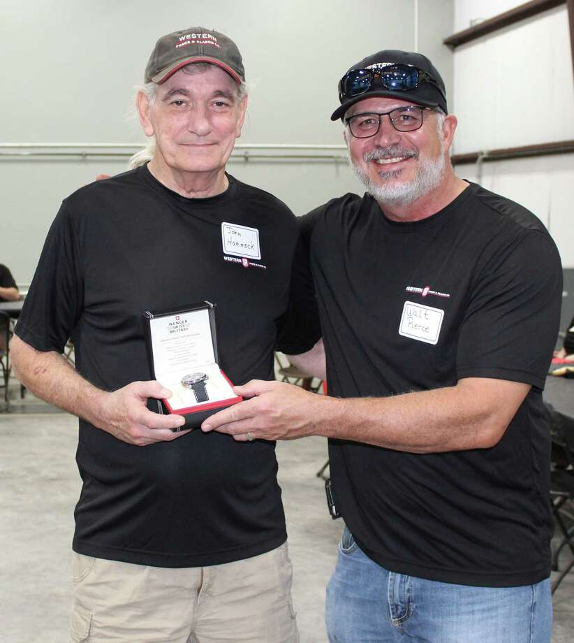 Western Forge President and CEO Walter Pierce (right) presents a Wenger Swiss Military watch to John Hammock iin honor of his retirement. Hammock has been an employee for Western Forge in Cleveland for nearly the entire 10 years it has existed in the city. Photo: Jacob McAdams