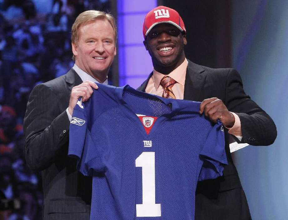 ASSOCIATED PRESS Nebraska cornerback Prince Amukamara poses for photographs with  NFL commissioner Roger Goodell after he ce5ad37cb