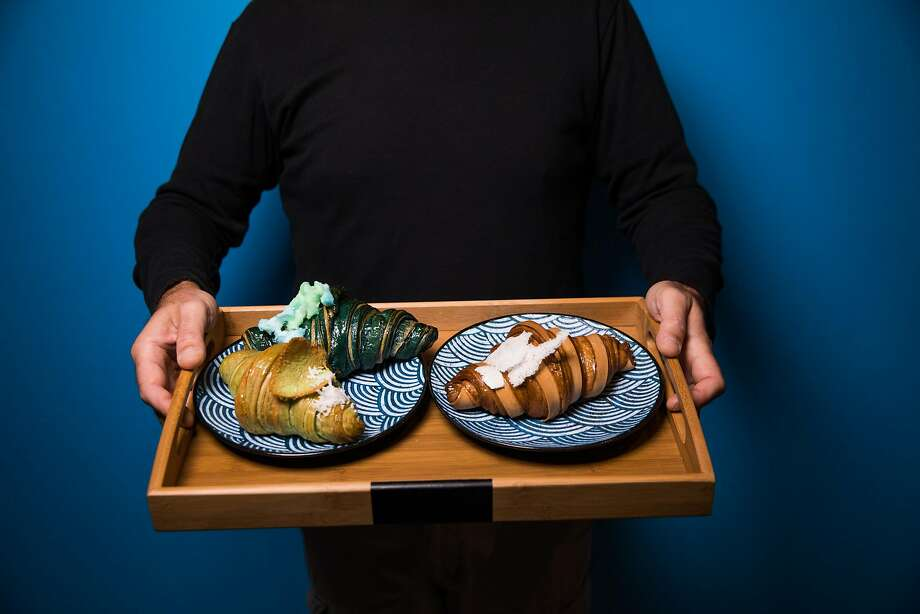 Baker Doe croissants at Enter the Cafe in Chinatown: On left plate, Blue Beard Dragon (top) and a pandan croissant with kaya. Right plate: A milk foam croissant. Photo: Mason Trinca, Special To The Chronicle