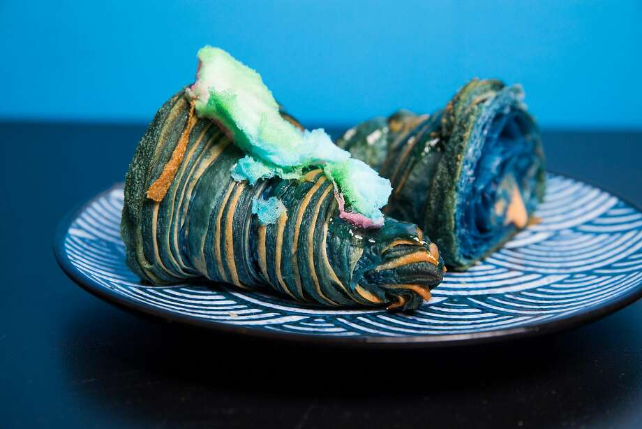 Baker Doe's Blue Beard Dragon bicolor croissant with chile orange curd and cotton candy. Photo: Mason Trinca, Special To The Chronicle