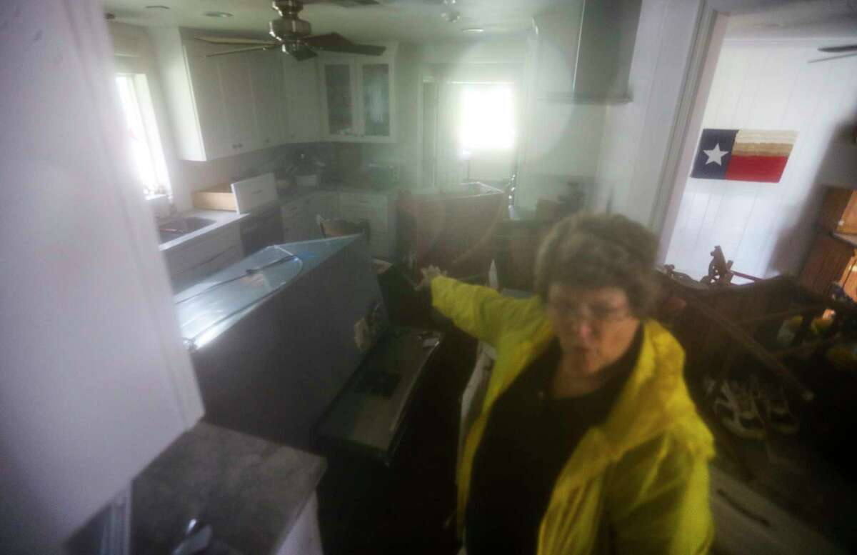 Ellen Bell shows her kitchen, remodeled after the 2015 flood, and how much water came into the house in Meyerland, Monday, Aug. 28, 2017, in Houston.