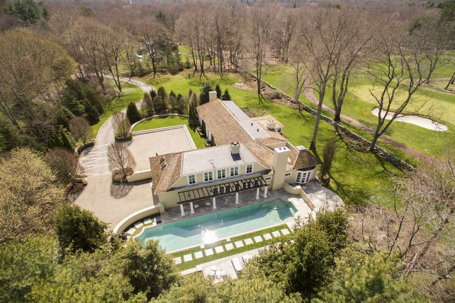 The central Darien estate at 3 Althea Drive features a nearly 6,100-square-foot French Provincial house, 60-foot in-ground swimming pool, and 1.56-acre property along the Wee Burn Country Club golf course.