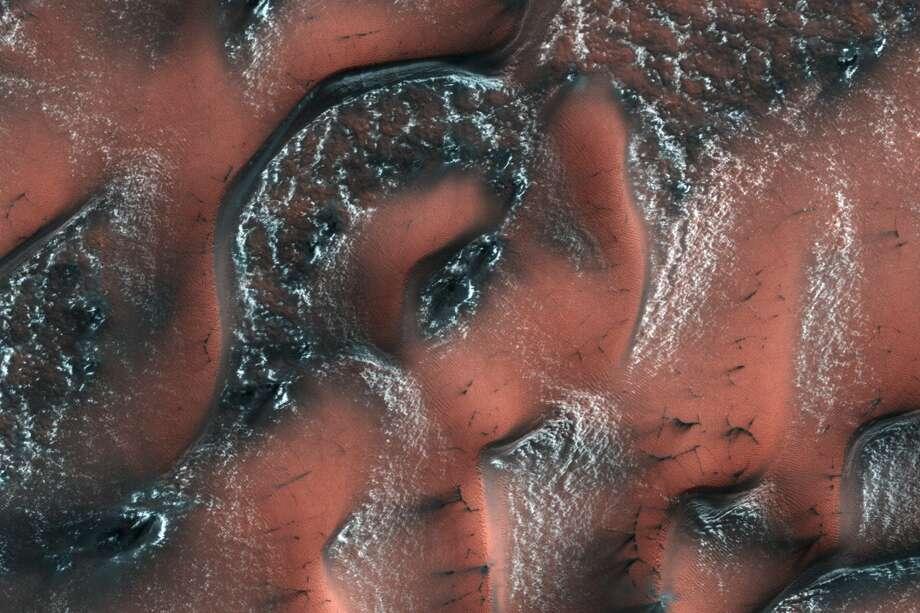 Snowy, dry-ice dunes on Mars' northern hemisphere are shown in this NASA photo. (Photo credit: NASA/JPL/University of Arizona)
