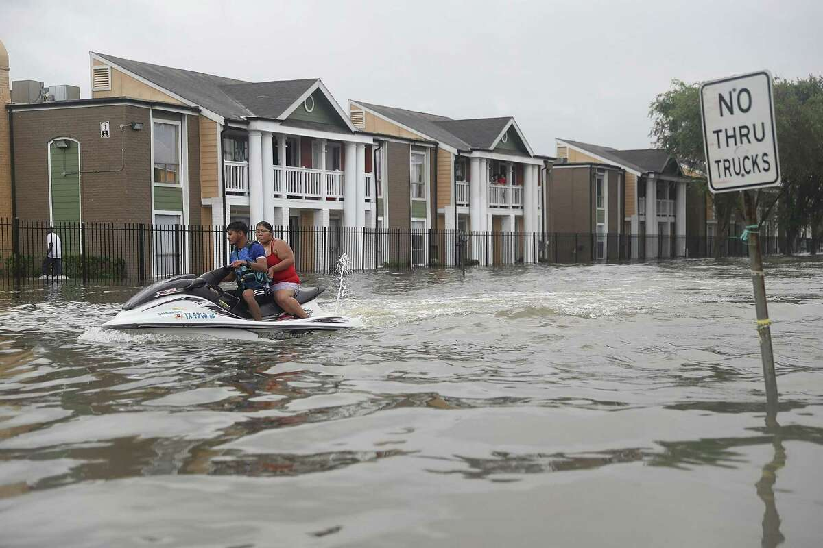 HOUSTON, TX - AUGUST 27: A Jetski is used to help people evacuate homes after the area was inundated with flooding from Hurricane Harvey on August 27, 2017 in Houston, Texas. Harvey, which made landfall north of Corpus Christi late Friday evening, is expected to dump upwards to 40 inches of rain in Texas over the next couple of days. (Photo by Joe Raedle/Getty Images)