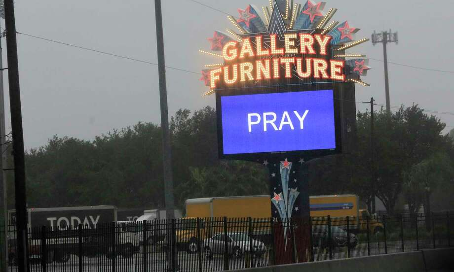 The marquis in front of the Gallery Furniture off of I-45, where the store took in some residents displaced Tropical Storm Harvey in Houston on  Monday, Aug. 28, 2017. Photo: Elizabeth Conley, Houston Chronicle / © 2017 Houston Chronicle