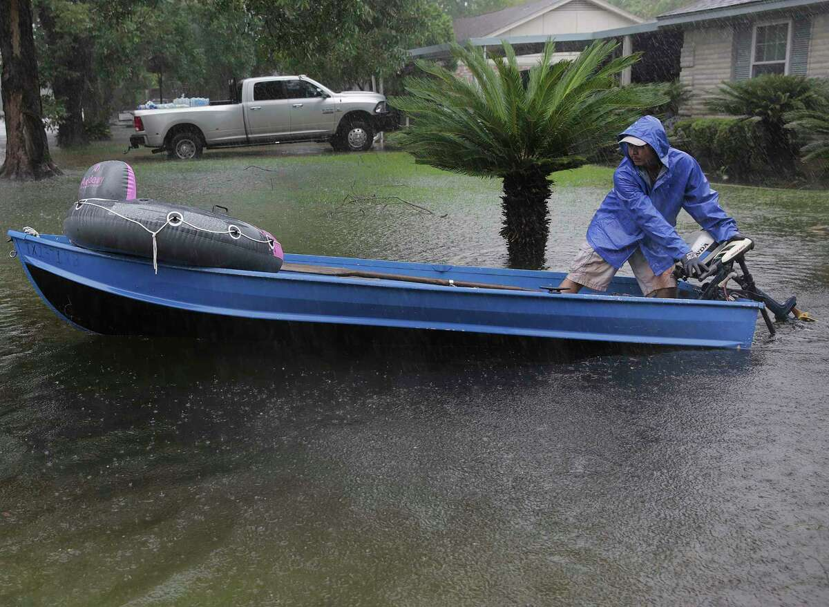 A volunteer gets his boat ready as he his way down the street in the Melrose Park neighborhood in Houston as Tropical Storm Harvey inches its way through the area on Monday, Aug. 28, 2017. >>Here is a dramatic rescue during Tropical Storm Harvey in and around Houston...