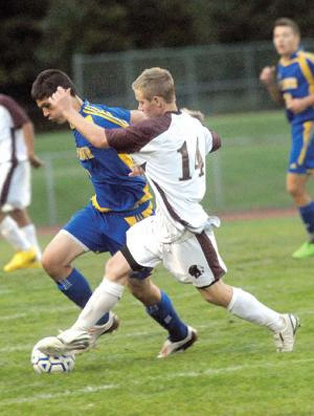 MIC NICOSIA/Register Citizen Torrington's Matt Rosengrant, right, and Seymour's Louis Krohelski fight for possession during Friday's game. Purchase a glossy print of this photo and more at www.registercitizen.com.