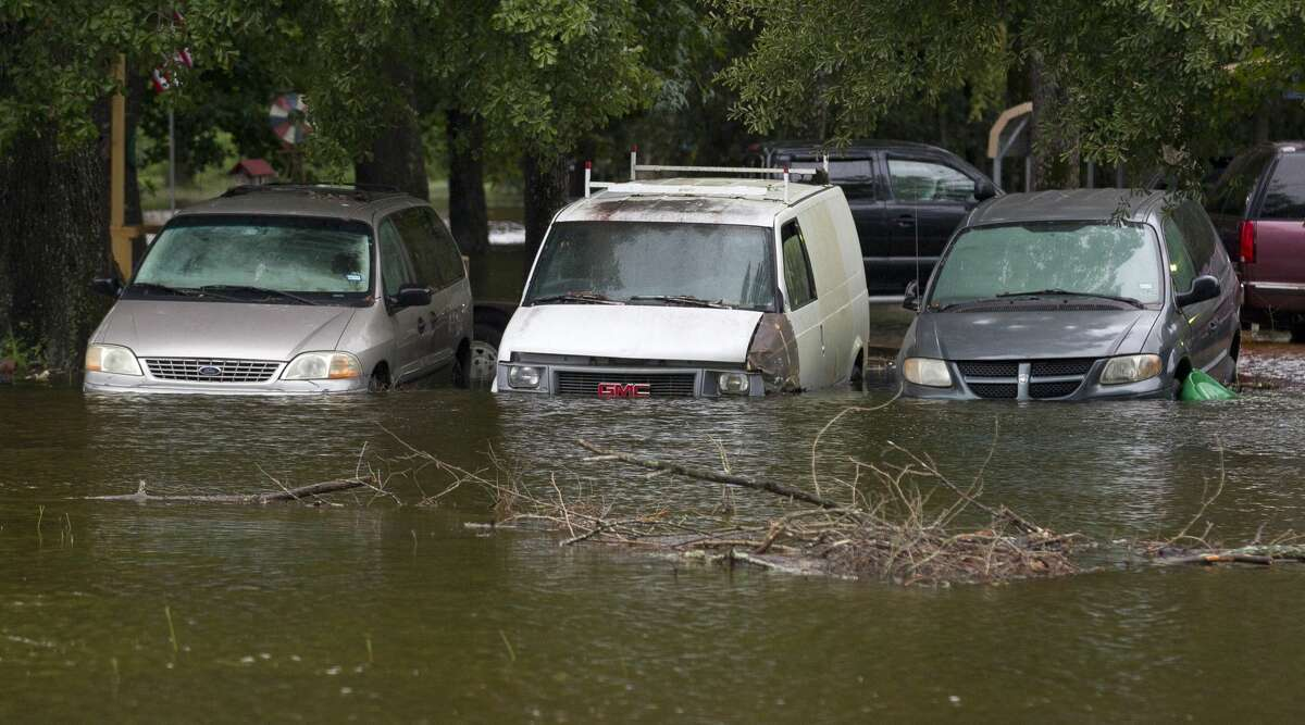 Cars are flooded with water in East Montgomery County, Monday, Aug. 28, 2017.