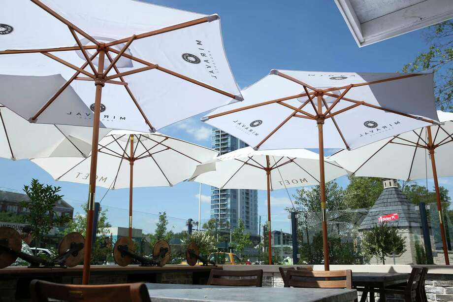 A'bouzy, a new champagne restaurant, has a patio with plenty of umbrellas. Photo: Yi-Chin Lee, Staff / © 2017  Houston Chronicle