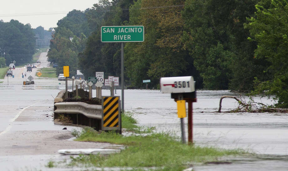 Water from the San Jacinto River crosses over on FM 2854 near the McDade Estates subdivision, Monday, Aug. 28, 2017, in Conroe. Photo: Jason Fochtman/Houston Chronicle