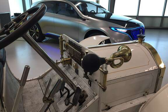 Two Mercedes on temporary display at the Mercedes-Benz Sunnyvale research lab. In the foreground, the 1902 Mercedes Simplex, in the background, the Concept EQ electric concept car.