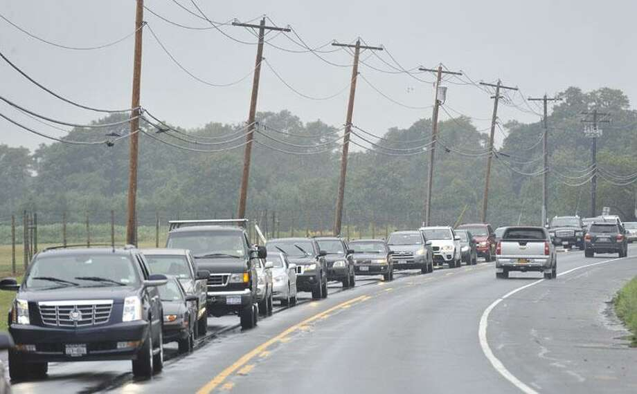 Traffic moves slowly heading east on Route 27, as Hurricane Earl approaches, Friday, Sept. 3, 2010 in Watermill, N.Y (AP Photo/Kathy Kmonicek) Photo: ASSOCIATED PRESS / FR170189 AP