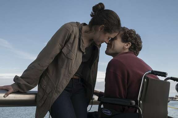 "This image released by Roadside Attractions shows Tatiana Maslany, left, and Jake Gyllenhaal in a scene from ""Stronger.""  (Scott Garfield/Lionsgate and Roadside Attractions via AP)"
