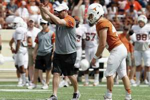 Head coach Tom Herman of the Texas Longhorns calls a timeout to ice Joshua Rowland before a field goal attempt during the spring game on April 15, 2017 in Austin.