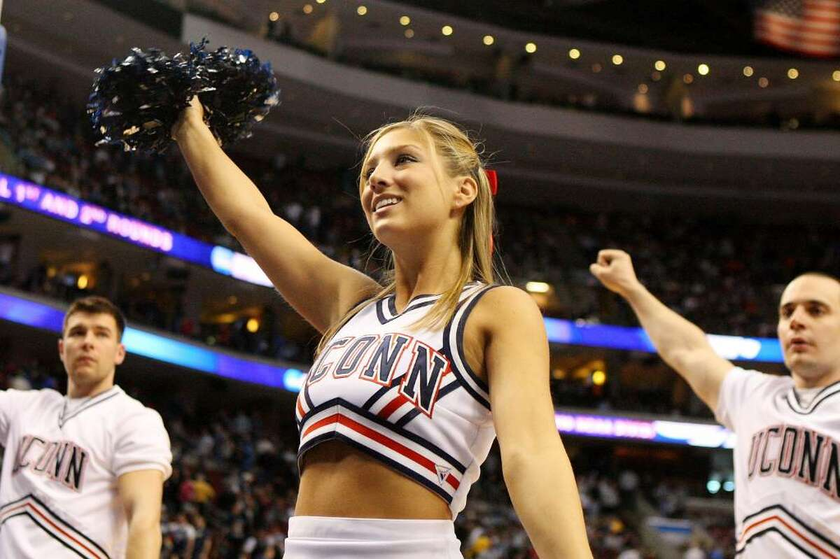 A federal judge is being asked to decide whether cheerleading can be counted as a sport by schools looking for ways to meet gender-equity requirements. The issue is part of a lawsuit filed by five members of the volleyball team at Connecticut's Quinnipiac University and coach Robin Sparks last year after the school decided in a budgetary move to eliminate women's volleyball in favor of a competitive cheer squad.