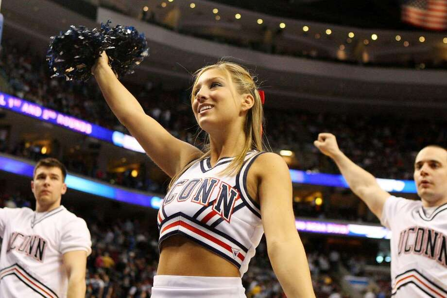 A federal judge is being asked to decide whether cheerleading can be  counted as a sport by schools looking for ways to meet gender-equity  requirements. The issue is part of a lawsuit filed by five members of  the volleyball team at Connecticut's Quinnipiac University and coach  Robin Sparks last year after the school decided in a budgetary move to  eliminate women's volleyball in favor of a competitive cheer squad. Photo: Jim McIsaac, Getty Images / 2009 Getty Images